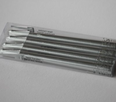 A box of four silver tapered candles