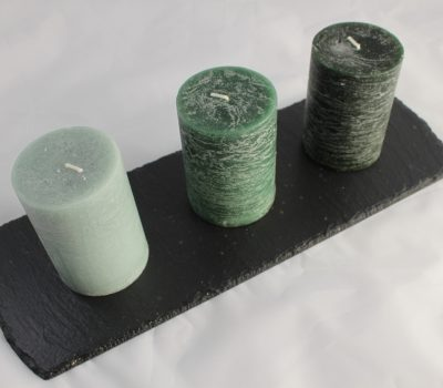 Three Green Shaded Candles On A Black Oblong Slate Base