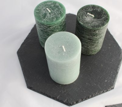 Three Green Shaded Candles On A Black Hexagonal Slate Base