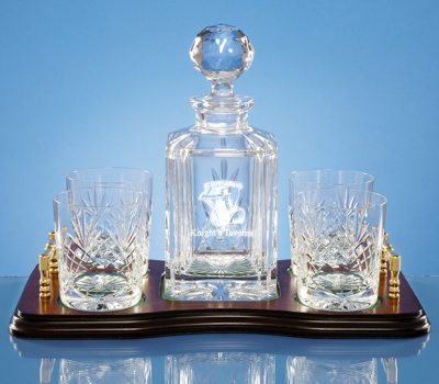Decanter and four glasses with wooden base